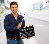 Happy Young Man Holding Clapboard — Stock Photo