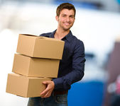 Young Man Holding Cardboxes — Stockfoto