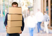 Man holding cardboard boxes — Stock Photo