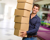 Young Man Holding Stack Of Cardboxes — Stock Photo