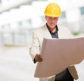 Mature Man With Hard Hat And Paper — Stock Photo