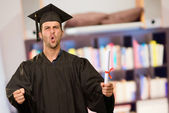 Young Graduation Man Holding Certificate — Stock Photo