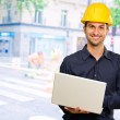 Happy Architect Holding Laptop — Stock Photo #19521715