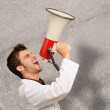Doctor Shouting In Megaphone And Gesturing - Stockfoto