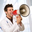 Male Doctor Shouting On Megaphone — Stock Photo #19522809