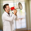 Male Doctor Shouting On Megaphone — Stock Photo #19522873
