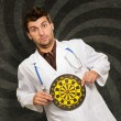Stock Photo: Expressive Young Doctor Holding Bulls Eye