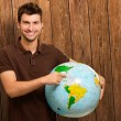 Young MShowing Destination On Globe — Stock Photo #19524485