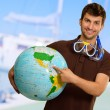 Man With Snorkel Holding Globe — Stock Photo