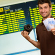 Young Man Holding Camera And Euro Currency — Stock Photo