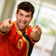 Portrait Of Excited Sportsman Pointing With Hand - Stock Photo