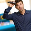 Portrait Of A Young Man Cutting His Hair — Stock Photo #19524923