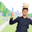 Young Man Balancing Book On Head — Stock Photo #19525691