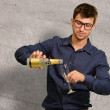Young Man Pouring Champagne Into Glass — Stock Photo #19525697