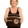 Happy Mature Woman Holding Radio — Stockfoto