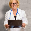 Female Doctor Holding X-ray — Stock Photo #19526315