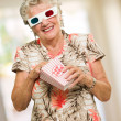 Senior Woman Eating Popcorn Watching 3d Movie — Stock Photo