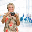 Senior Woman Clicking Photo — Stockfoto