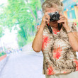 Senior Woman Capturing Photo - Stock Photo