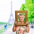 Senior Woman Holding Picture Frame - Photo