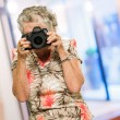 Mature Woman Capturing Photo — Stock Photo #19527909