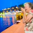 Senior Woman Clicking Photo — Stock Photo #19527953