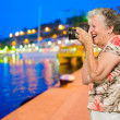 Senior Woman Clicking Photo - Stock Photo