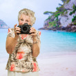 Senior Woman Holding Camera — Stock Photo #19527993