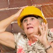Senior Woman Wearing Hard Hat — Stock Photo #19528087