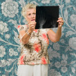 Senior Woman Holding X Ray Report - Stock Photo