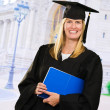 Happy Graduate Woman Holding a notebook - Stock Photo