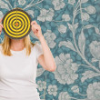 Portrait Of A Woman Holding Dartboard — Stock Photo #19529869