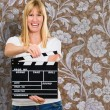 Happy Woman Holding Clapper Board — Stock Photo #19529901