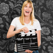 Pretty woman holding a clapper board - Foto de Stock  