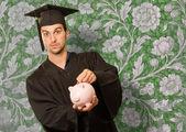 Diplom mann betrieb sparschwein — Stockfoto