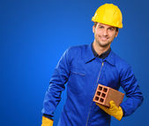 Happy Engineer Holding Brick — Stock Photo