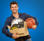 Happy Young Man Holding Cardboxes Gesturing — Stock Photo