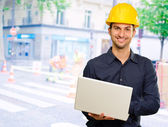 Happy Architect Holding Laptop — Stock Photo