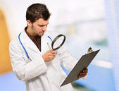 Young Doctor Looking Through Magnifying Glass — Stock Photo