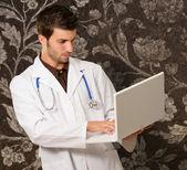 Portrait Of Doctor Holding Laptop — Stock Photo