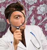 Portrait Of A Doctor Looking Through Magnifying Glass — Stok fotoğraf