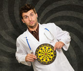 Expressive Young Doctor Holding Bulls Eye — Stock Photo