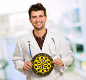 Happy Young Doctor Holding Bulls Eye — Stock Photo