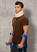 Disabled Man With Neck Brace Holding Euro Note — Stock Photo