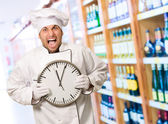 Male Chef Holding Wall Clock — Stock Photo