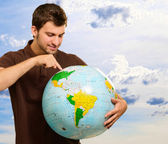 Young Man Searching On Globe — Stock Photo