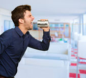 Man Shouting In Tin Can Telephone — Stock Photo