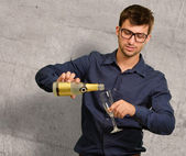 Young Man Pouring Champagne Into Glass — Stock Photo