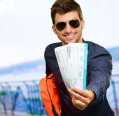 Happy Man Holding Life Jacket And Boarding Pass — Stock Photo