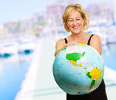 Mature Woman Holding Globe — Stock Photo